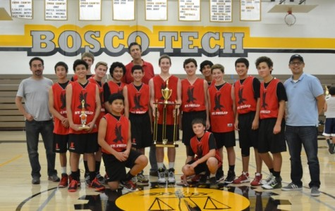 The Varsity Basketball team with their trophies after winning the Don Bosco Tech