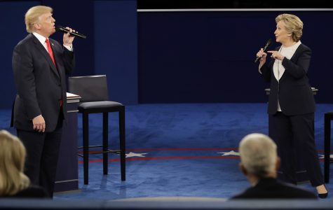 Republican presidential nominee Donald Trump and Democratic presidential nominee Hillary Clinton exchange views during the second presidential debate at Washington University in St. Louis, Sunday, Oct. 9, 2016. (AP Photo/Julio Cortez)