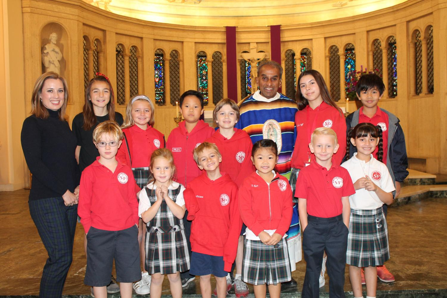 Ms. Tricia is pictured here with her school family when they led mass.